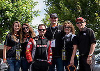 Aug. 4, 2013; Kent, WA, USA: NHRA top fuel dragster driver Steve Torrence with friends during the Northwest Nationals at Pacific Raceways. Mandatory Credit: Mark J. Rebilas-USA TODAY Sports