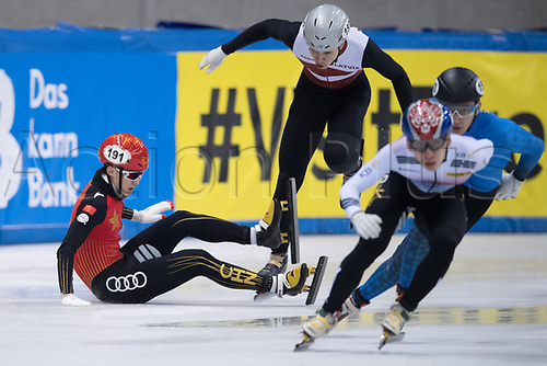 01 February 2019, Saxony, Dresden: Shorttrack: World Cup, quarter finals, 1500 meter men in the EnergieVerbund Arena. Jialong Tian (l) from China crashes in a curve behind Roberts Kruzbergs (2nd from left) from Latvia.