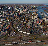 aerial photograph of Cite du Havre, Montreal, Quebec, Canada in the fall. Costco warehouse in the foreground, financial district left, Saint Lawrence River right