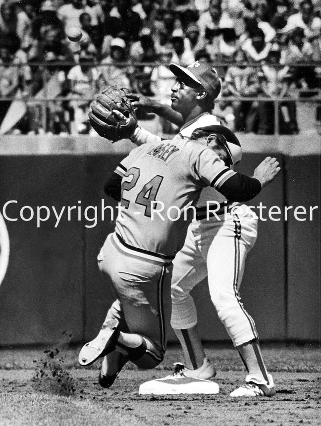 Oakland A's 2nd baseman Shooty Babitt takes throw ,<br />Balitmore's Rick Dempsey slides..(1981 photo by Ron Riesterer)