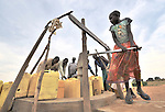 Women and girls fetch water at a well provided by the United Methodist Committee on Relief (UMCOR) in Yei, Southern Sudan... NOTE: In July 2011, Southern Sudan became the independent country of South Sudan