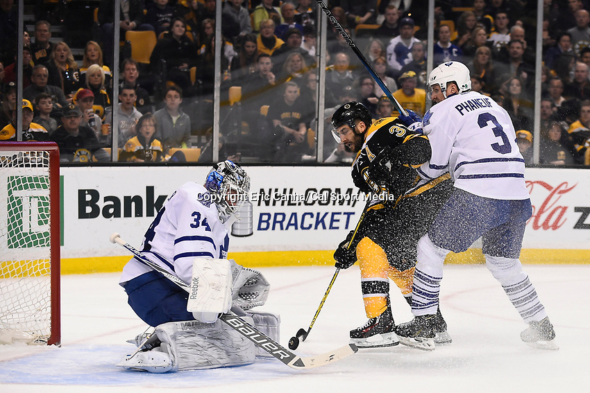 April 4, 2015 - Boston, Massachusetts, U.S. - Boston Bruins center Patrice Bergeron (37) takes a shot on Toronto Maple Leafs goalie James Reimer (34) during the NHL match between the Toronto Maple Leafs and the Boston Bruins held at TD Garden in Boston Massachusetts. Eric Canha/CSM