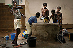 World Water Day. Children are washing themselves at the well of a little village