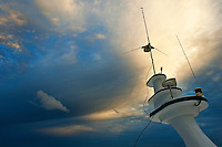 Antennas of a diver's cruise boat at sunset, Maldives.
