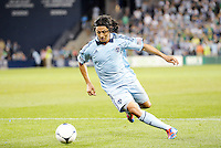 Roger Espinoza (15) midfielder Sporting KC in action... Sporting Kansas City defeated New England Revolution 3-0 at LIVESTRONG Sporting Park, Kansas City, Kansas.