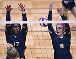 The ball slips between Althoff players Payton Jackson (left) and Karinna Gal as they leap to block. Althoff lost to Minooka in the championship game of the O'Fallon Class 4A volleyball sectional at O'Fallon HS in O'Fallon, IL on November 6, 2019.<br /> Tim Vizer/Special to STLhighschoolsports.com