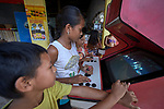 Children play video games in the Nacoes Indigenas neighborhood in Manaus, Brazil. The neighborhood is home to members of more than a dozen indigenous groups, many of whose members have migrated to the city in recent years from their homes in the Amazon forest.