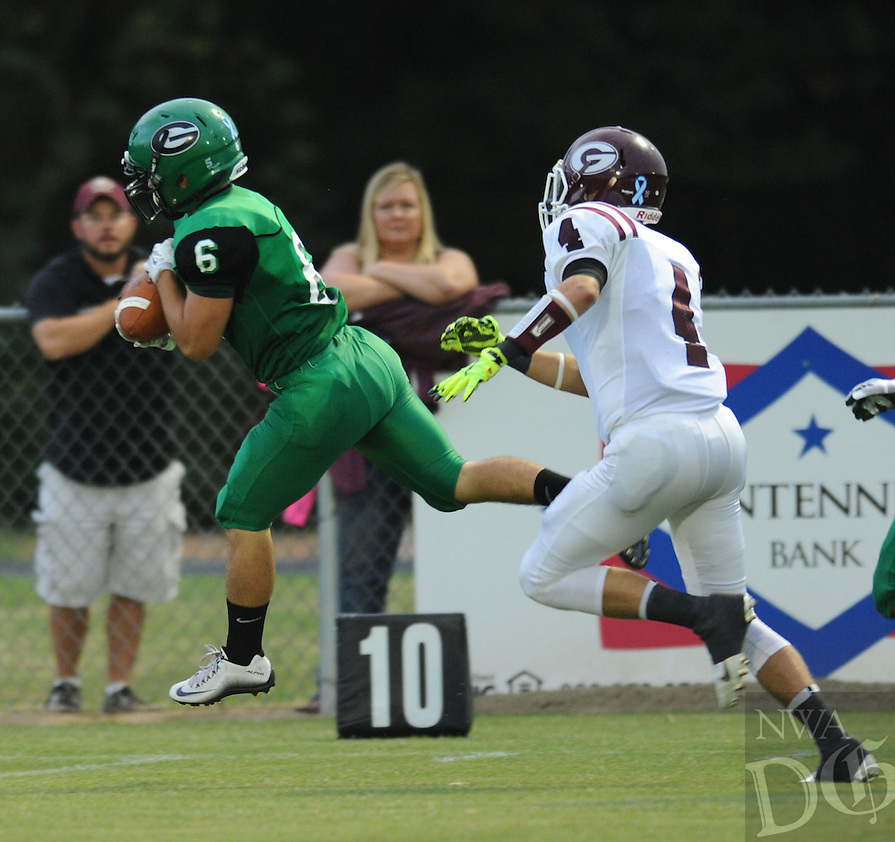 NWA Democrat-Gazette/ANDY SHUPE<br /> Alex Sisemore (6) of Greenland pulls down a touchdown pass in front of Jake Faulkenberry (4) of Gentry Friday, Sept. 18, 2015, during the first half of play at Jonathan Ramey Memorial Stadium in Greenland. Visit nwadg.com/photos to see more photographs from the game.
