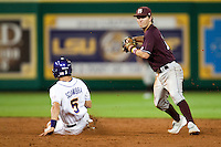 Mississippi State Bulldog shortstop Adam Frazier #12 turns a double play as LSU Tigers Chris Sciambra #5 slides at the NCAA baseball game on March 16, 2012 at Alex Box Stadium in Baton Rouge, Louisiana. LSU defeated Mississippi State 3-2 in 10 innings. (Andrew Woolley / Four Seam Images)