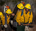 Firefighters walk out of the active burning area of the Soberanes Fire near Chews Ridge in the Los Padres National Forest on Sept. 24., 2016.