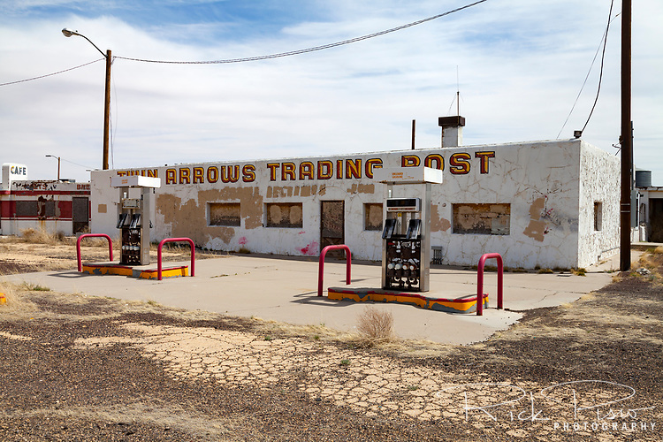 The closed Twin Arrows Trading Post in Arizona. Located east of Flagstaff the stop with its trademark bright yellow twin arrows once catered to Route 66 travelers with gas, curios, and an 8 stool diner. Opened originally as the Padre Canyon Trading Post in 1949 the name was later changed to Twin Arrows and pair of 25 foot arrows were constructed. The trading post was closed in 1998.