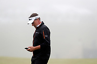 Ian Poulter (ENG) walks off the 18th green and to the clubhouse as the fog sets in behind him during the Wednesday practice round of the 118th U.S. Open Championship at Shinnecock Hills Golf Club in Southampton, NY, USA. 13th June 2018.<br /> Picture: Golffile | Brian Spurlock<br /> <br /> <br /> All photo usage must carry mandatory copyright credit (&copy; Golffile | Brian Spurlock)
