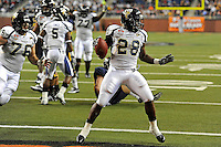 26 December 2010:  FIU running back Darriet Perry (28) celebrates after scoring a touchdown in the third quarter as the FIU Golden Panthers defeated the University of Toledo Rockets, 34-32, to win the 2010 Little Caesars Pizza Bowl at Ford Field in Detroit, Michigan.