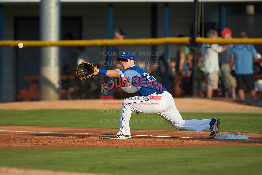 Burlington Royals first baseman Chris Hudgins (27) stretches for a throw during the game against the Kingsport Mets at Burlington Athletic Stadium on July 27, 2018 in Burlington, North Carolina. The Mets defeated the Royals 8-0.  (Brian Westerholt/Four Seam Images)