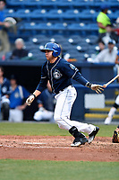 Asheville Tourists left fielder Cole Anderson (16) swings at a pitch during a game against the Greensboro Grasshoppers at McCormick Field on April 27, 2017 in Asheville, North Carolina. The Tourists defeated the Grasshoppers 8-5. (Tony Farlow/Four Seam Images)