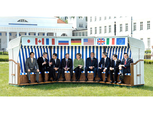 Heiligendamm, Germany - June 7, 2007 -- The G-8 Heads of State and Government seated in a wicker beach chair (from left to right) Prime Minister Shinzo Abe of Japan, Prime Minister Stephen Harper  of Canada, President Nicolas Sarkozy of France, President Vladimir Putin of Russia, Chancellor Angela Merkel of Germany, United States President George W. Bush, Prime Minister Tony Blair of the United Kingdom, Prime Minister Romano Prodi of Italy and President of the European Commission José Manuel Barroso..Mandatory Credit: BPA via CNP