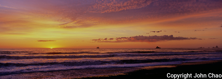 Panoramic view of a sunset on the horizon off Rialto Beach, Olympic National Park, Washington State.