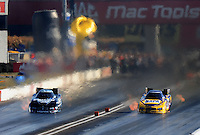 Sept. 5, 2010; Clermont, IN, USA; NHRA funny car driver Matt Hagan (left) races alongside teammate Ron Capps during qualifying for the U.S. Nationals at O'Reilly Raceway Park at Indianapolis. Mandatory Credit: Mark J. Rebilas-
