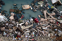 Waste and discarded mannequines in the polluted canal in Beijing, China..12-MAR-04