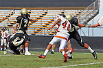 Palos Verdes, CA 09/22/11 - Tony Bumatay (Peninsula #7) and Ian Escutia (Peninsula #2) and Jack Doty (Peninsula #78)) in action during the Beverly Hills-Peninsula Varsitty Football gane.