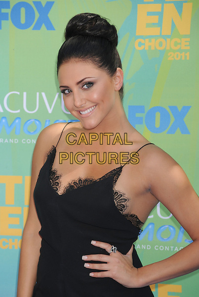 Cassie Scerbo.2011 Teen Choice Awards - Arrivals held at Gibson Amphitheatre, Universal City, California, USA..August 7th, 2011.half length hand on hip dress black lace hair up dyed brunette bun .CAP/ROT/TM.©Tony Michaels/Roth Stock/Capital Pictures
