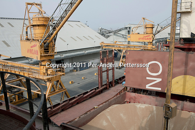 DJIBOUTI, DJIBOUTI - AUGUST 4: Forty thousand tons of wheat bound to Ethiopia is off loaded from a cargo ship to the WFP, World Food Program storage facility in the Djibouti port on August 4, 2011 out Djibouti, Djibouti. A severe drought has added to the misery and hardship in the Horn Of Africa. Many refugees has fled Somali and arrived in Kenya, Ethiopia and Djibouti. A Russian Vessel hired by WFP arrived with 40,000 tons of wheat. The wheat is pumped out and put into bags that weigh fifty kilograms each.  (Photo by Per-Anders Pettersson)