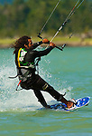 "A kiteboarder catches the wind at 'the Spit"" in Squamish, BC"