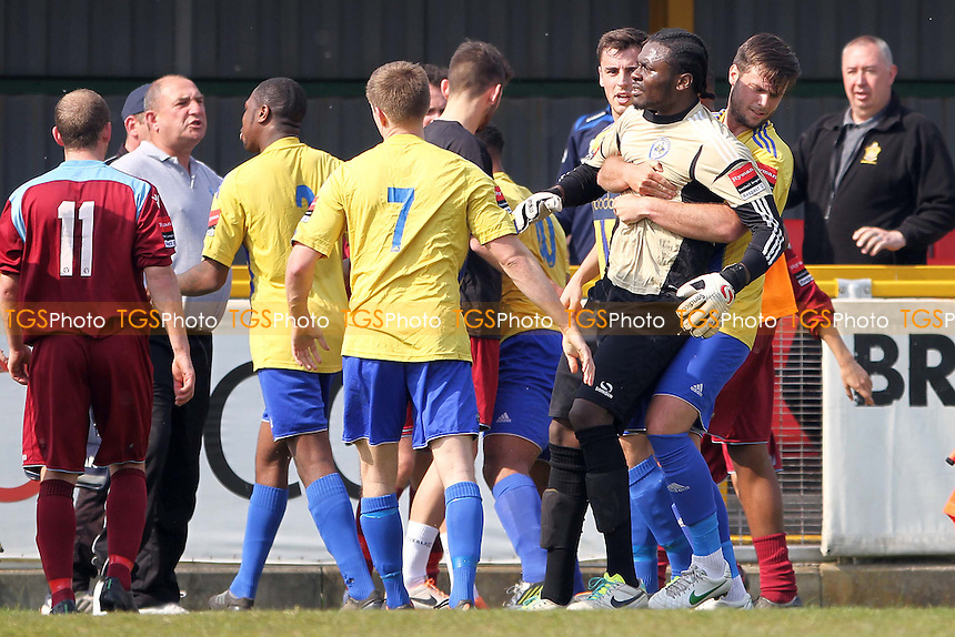 Atu Ngoy (Romford) being held as tempers flair - Romford vs Brentwood Town - Ryman League Division One North Football at Ship Lane, Thurrock FC - 21/04/14 - MANDATORY CREDIT: Mick Kearns/TGSPHOTO - Self billing applies where appropriate - 0845 094 6026 - contact@tgsphoto.co.uk - NO UNPAID USE