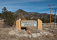 A sign for Pinewoods Springs near the Arapahoe-Roosevelt National Forest in Pinewood Springs, Colorado, Wednesday, February 1, 2012. National Forests in Colorado could, under rule making now going on in the Obama administration, have much reduced protections from development than the rest of the nation under the so-called roadless rules, proposed in the Clinton administration, and recently vindicated by a federal appeals panel..Photo by Matt Nager