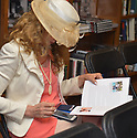CORAL GABLES, FL - APRIL 10: Fans reading Gigi Gorgeous book during a Q&A and book signing to Promotes Her New Book 'He Said, She Said: Lessons, Stories, and Mistakes from My Transgender Journey' at Books and Books on April 10, 2019 in Coral Gables, Florida.  ( Photo by Johnny Louis / jlnphotography.com )