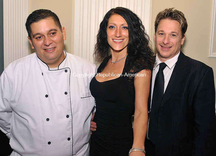 WATERBURY, CT-20 OCTOBER 2011-102011S16--Cristian Concha, chef at Casa Dijanna in Watertown with owner Dijanna Barbino and her husband Richard Barbino at the Morris Foundation and Wellpath's &quot;In Good Taste&quot;  food tasting event Thursday October 20, at the Ponte Club in Waterbury. The event was a fundraiser to benefit the Wellmore&rsquo;s Woman &amp; Children&rsquo;s Programs. The Morris Foundation and Wellpath will soon merge and become Wellmore.<br />  Jim Shannon Republican-American