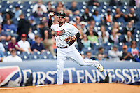 Nashville Sounds third baseman Renato Nunez (34) throws to first during a game against the Iowa Cubs on May 4, 2016 at First Tennessee Park in Nashville, Tennessee.  Iowa defeated Nashville 8-4.  (Mike Janes/Four Seam Images)