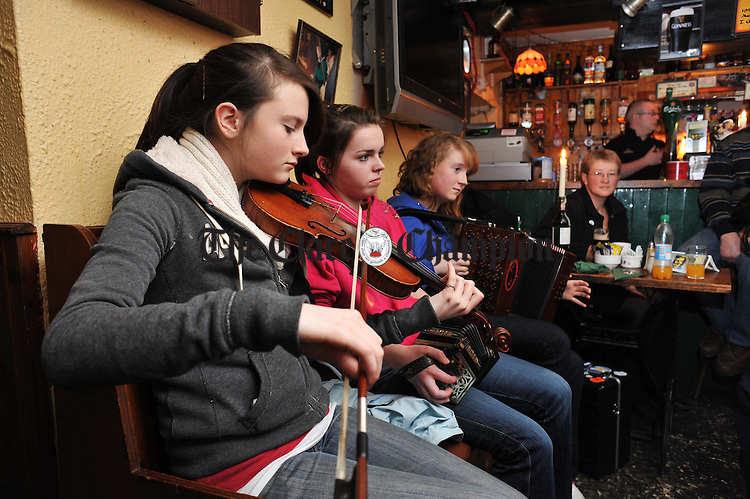 Sorcha Crimmins, Aisling Lyons and Aisling Hunt, members of the Tulla Junior Ceili Band, performing in a session as part of the 200th anniversary celebrations at Peppers of Feakle. Photograph by John Kelly.