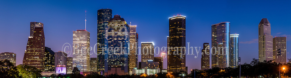 A great panorama of Houston skyline at night in the downtown area which include all the high rise buildings like the Well Fargo, Smith Street, the American Bank, Heritage Plaza and more.