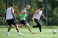 Oli McBurnie (left) vies for possession with Martin Olsson (right) of Swansea City during the Swansea City Training Session at The Fairwood Training Ground, Wales, UK. Thursday 30th August 2018