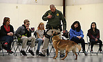 Carson City Sheriff's Deputy Jimmy Surratt and his K-9 partner Ary demonstrate patrol skills for a group of GATE students from Carson Middle and Eagle Valley Middle schools, on Wednesday, March 5, 2014 at Fuji Park.<br /> Photo by Cathleen Allison/Nevada Photo Source