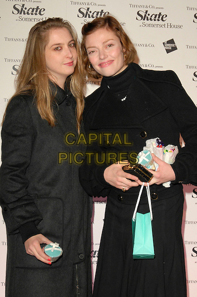 DAISY DE VILLENEUVE & CAMILLA RUTHERFORD.At Somerset House Ice Rink VIP Launch Party, London, England, November 20th 2007. .half length black coat Tiffany's bag.CAP/CAN.©Can Nguyen/Capital Pictures