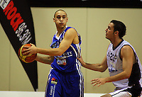 Bronson Beri tries to block Saints guard Lindsay Tait during the NBL Round 12 match between the Wellington Saints and Nelson Giants at TSB Bank Arena, Wellington, New Zealand on Thursday 15 May 2008. Photo: Dave Lintott / lintottphoto.co.nz