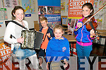 Kerry Fleadh Cheoil : Trying out new instruments at the Kerry Fleadh Cheoil in Ballybunion on Sunday last were Aisling & Danny Keane, Aine Enright & Roisin Kissane.