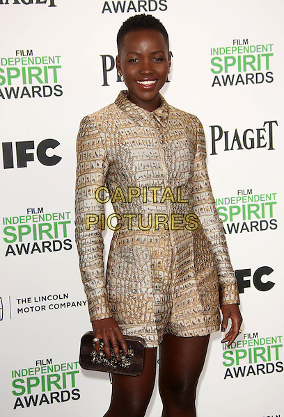 SANTA MONICA, CA - March 01: Lupita Nyong'o at the 2014 Film Independent Spirit Awards Arrivals, Santa Monica Beach, Santa Monica,  March 01, 2014. Credit: Janice Ogata/MediaPunch<br /> CAP/MPI/JO<br /> &copy;JO/MPI/Capital Pictures
