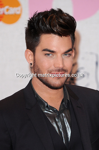 NON EXCLUSIVE PICTURE: PAUL TREADWAY / MATRIXPICTURES.CO.UK<br /> PLEASE CREDIT ALL USES<br /> <br /> WORLD RIGHTS<br /> <br /> American singer Adam Lambert attending the BRIT Awards 2015 at the O2 Arena, in London.<br /> <br /> FEBRUARY 25th 2015<br /> <br /> REF: PTY 15627