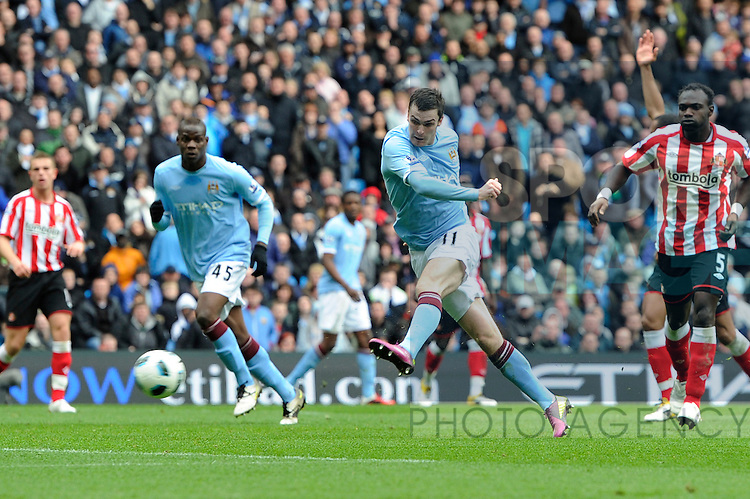 Adam Johnson of Manchester City volleys in a shot that is saved