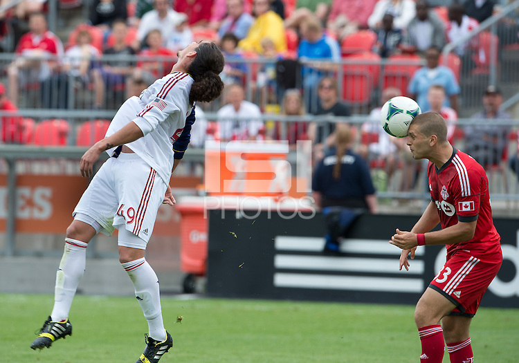 29 June 2013: Real Salt Lake forward Devon Sandoval #49 and Toronto FC midfielder Ryan Richter #33 in action during an MLS game between Real Salt Lake and Toronto FC at BMO Field in Toronto, Ontario Canada.<br /> Real Salt Lake won 1-0.