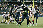 Seattle Seahawks  running back Marshawn Lynch (24) runs around left end to score on a 14-yard run against the San Francisco 49ers in the third quarter at CenturyLink Field in Seattle, Washington on September 15, 2013.  Lynch finished with 135 total yards, including 98 yards rushing yards on 28 carries, scored three touchdowns in the Seattle Seahawks 29-3 win over the 49ers .  The Seahawks beat the 49ers 29-3. ©2013. Jim Bryant Photo. ALL RIGHTS RESERVED.