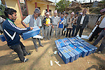 Newly trained masons and carpenters receive their toolboxes at the end of an ACT Alliance-sponsored course in Dhawa, a village in the Gorkha District of Nepal. In the wake of the 2015 earthquake that ravaged the region, Dan Church Aid, a member of the ACT Alliance, has provided a variety of support for villagers here, including preparing these workers to build new houses once the Nepali government disburses funds for construction.