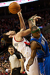 04/03/11--Blazers' Rudy Fernandez is tangled up with Mavericks guard Jason Terry in the second half at the Rose Garden in Portland, Or..Portland defeated Dallas 104-96..Photo by Jaime Valdez............................................