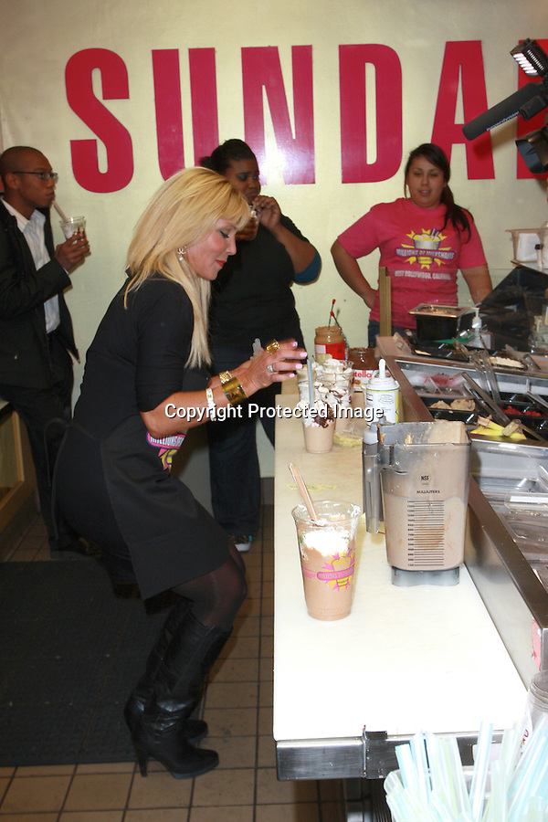 "Pamela Bach-Hasselhoff launched her shake at Millions of Milkshakes....1-3-2010  ....(Hollywood,CA) Jan 3rd 2010. Actress Pamela Bach-Hasselhoff launched her own Milkshake in style at famous celeb hotspot Millions of Milkshakes Sunday night. This was indeed a night to remember as the Former Baywatch star and Ex wife to David Hasselhoff arrived with 5 of her foster kids from Hollywood's Covenant House that helps restore hope in unfortunate kids. ..It was a media Frenzy as always as fans and photogs among others stormed the West Hollywood hotspot previously visited by the likes of Lindsay Lohan, Miley Cyrus, the Kardashians, Donny Osmond and many more. ..Pamela wanted to start the new year with a positive note and thus named her signature shake: ..""THE NEW VISION SHAKE"" that has the following contents: Peanut Butter, Chocolate Syrup, Vanilla Low Fat Yogurt, Almonds, Kiwi, Bananas, Whipped Cream with a Cherry on Top! ..Lets stay tuned for the next chapter as you never know who might show up next at Millions of Milkshakes. Celebrities just can't seem to get away from this spot.....Abilityfilms@yahoo.com.805-427-3519.www.AbilityFilms.com."