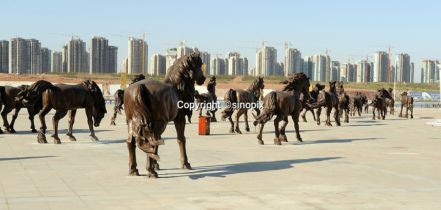 One hundred horse bronze scuptures near the artificial river in Kangbashi district of the Chinese city of Ordos, Inner Mongolia. 12-May-2011