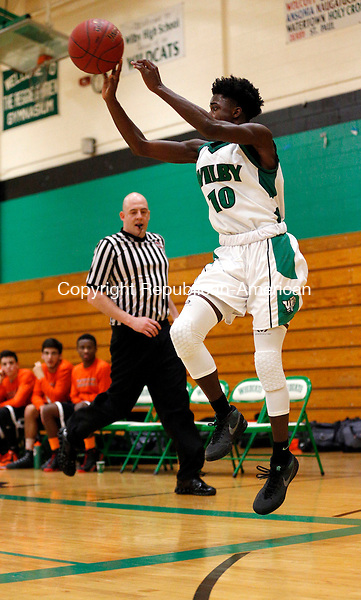 Waterbury, CT- 07 January 2016-010716CM07- Wilby's Ty'Quay Harding  saves the ball from out of bounds against Watertown during their NVL matchup in Waterbury on Thursday.     Christopher Massa Republican-American