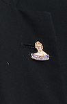 "Close up of Ally McCoist's lapel badge ""Sandy Jardine Rangers Legend""."